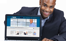 Photo of a young man with a computer screen showing the Apex Payroll website